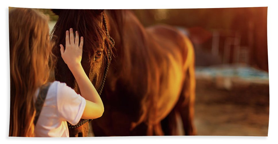 Woman Hand Towel featuring the photograph Young Blonde Girl Stroking A Brown Horse. by Jan Pavlovski
