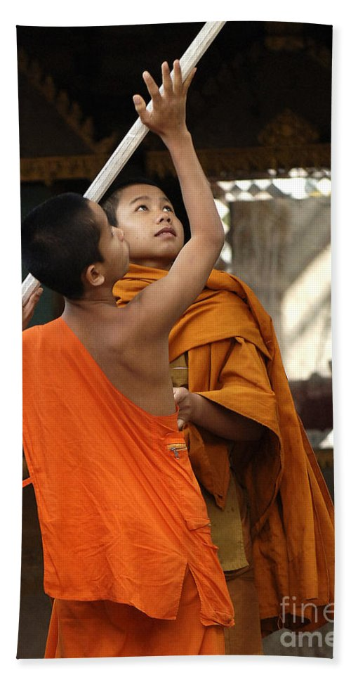Monk Hand Towel featuring the photograph Young Buddhist Monks Laos by Bob Christopher