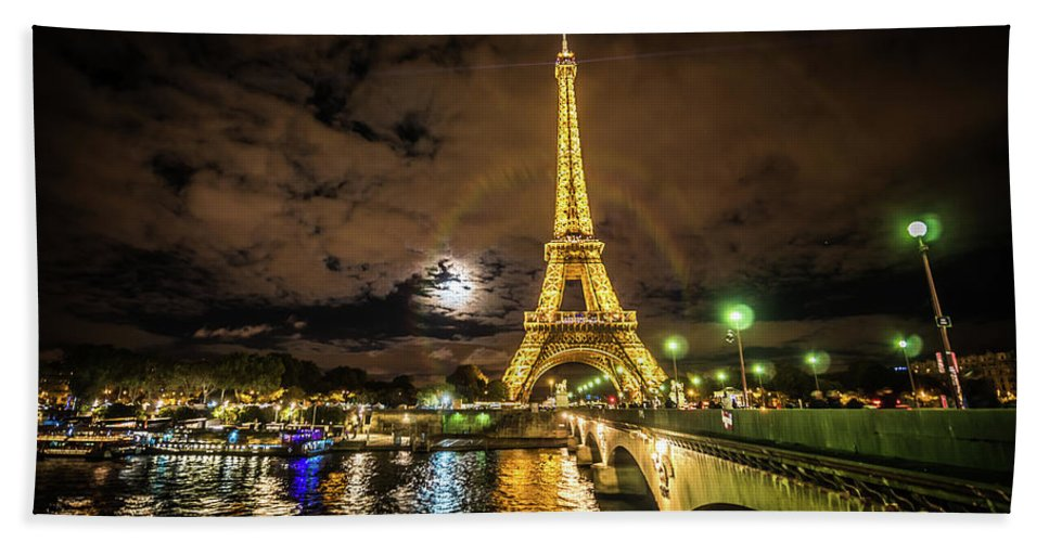 1889 Exposition Bath Towel featuring the photograph Eiffell Tower At Night After The Storm Passed by PorqueNo Studios