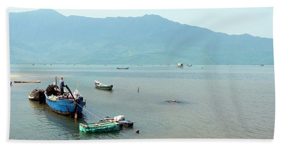 Fisherman In Lang Co Vietnam Hand Towel featuring the photograph Fisherman In Lang Co, Vietnam by Madeline Ellis
