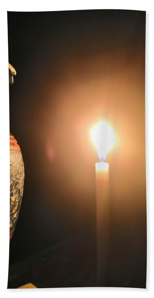 Candle Light Bath Towel featuring the photograph Light In The Dark by Ian Batanda