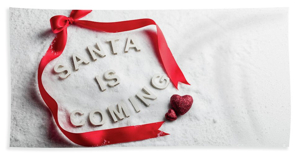 Christmas Bath Towel featuring the photograph Santa Is Coming Text And Red Ribbon by Michal Bednarek