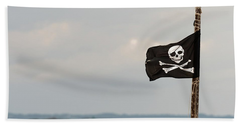 Pirate Bath Sheet featuring the photograph Small Jolly Roger On A Wooden Pole by Stefan Rotter