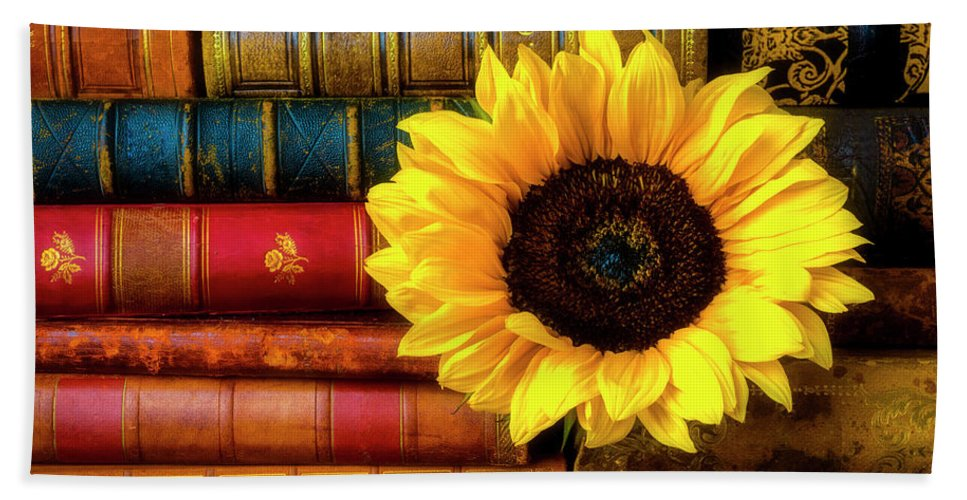 Book Hand Towel featuring the photograph Sunflower In Stack Of Books by Garry Gay