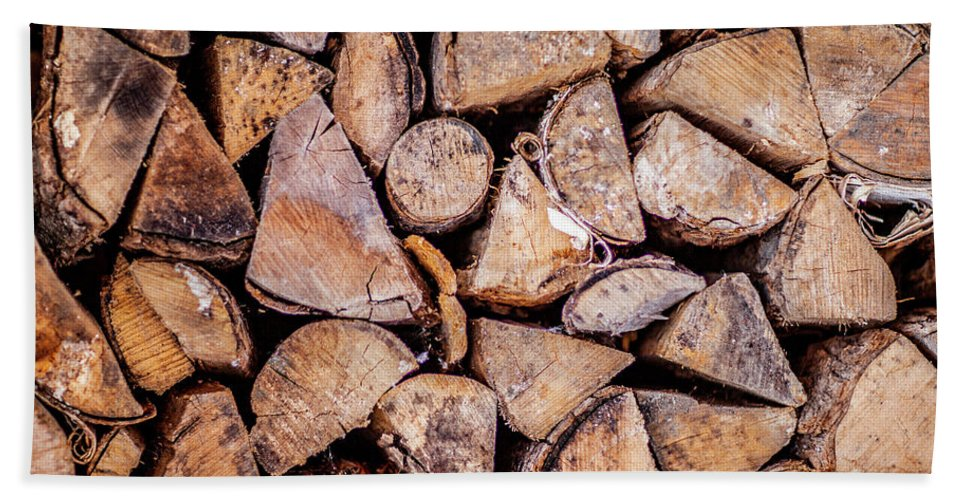 Wood Pile Bath Towel featuring the photograph Wood Pile by Trevor Slauenwhite