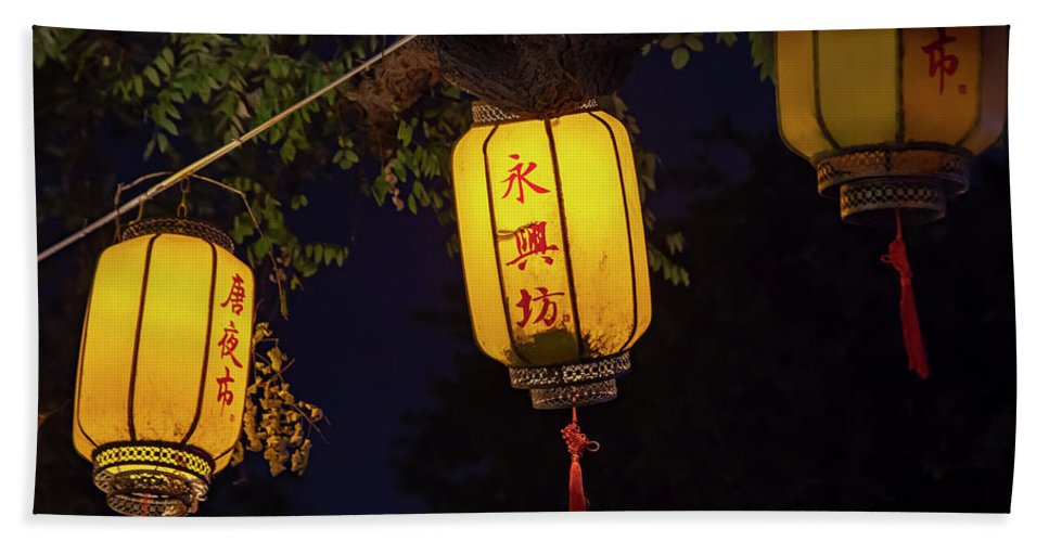 Asia Bath Sheet featuring the photograph Yellow Chinese Lanterns On Wire Illuminated At Night by Karen Foley