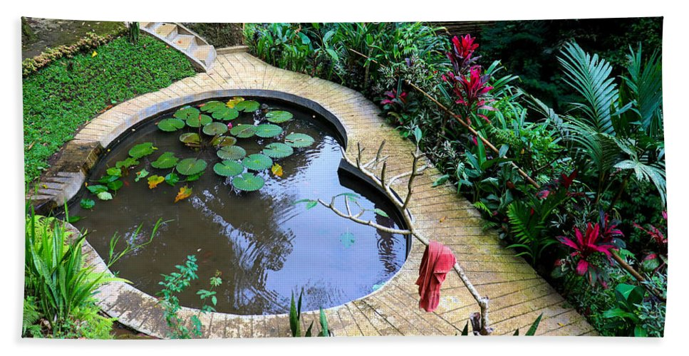 Heart Hand Towel featuring the digital art Heart-shaped pond with water lilies by Worldvibes1