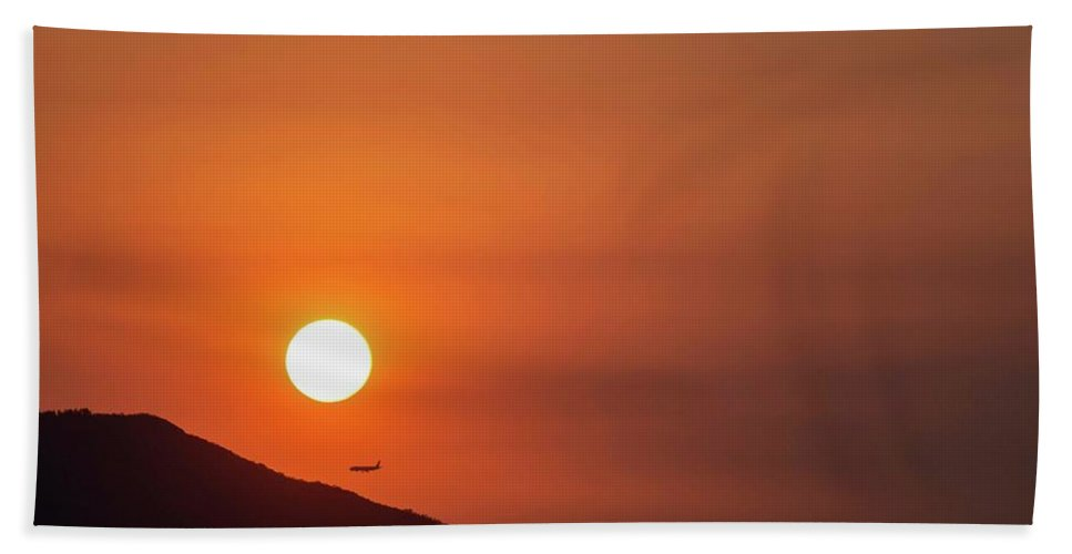 Sunset Bath Towel featuring the photograph Red sunset and plane in flight by Hannes Roeckel
