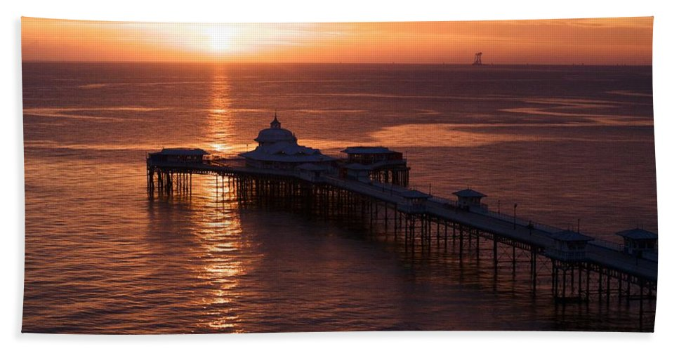 Piers Bath Towel featuring the photograph Sunrise over Llandudno pier 2 by Christopher Rowlands