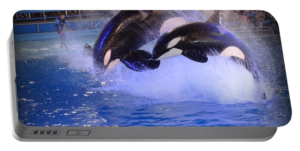 Orca Portable Battery Charger featuring the photograph 0678 by Onyx Armstrong