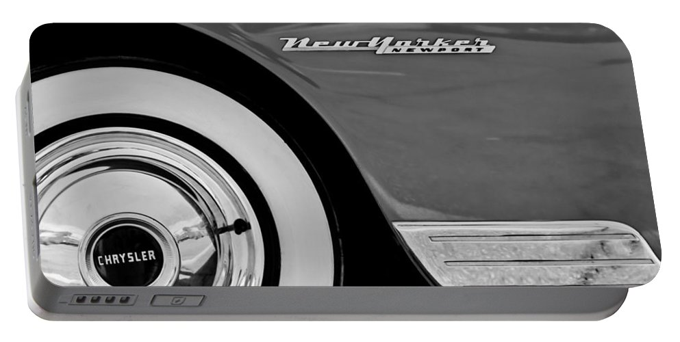 1950 Chrysler New Yorker Coupe Wheel Emblem Portable Battery Charger featuring the photograph 1950 Chrysler New Yorker Coupe Wheel Emblem by Jill Reger