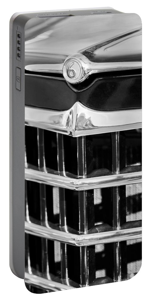 1950 Willys Jeepster Grille Emblem Portable Battery Charger featuring the photograph 1950 Willys Jeepster Grille Emblem by Jill Reger