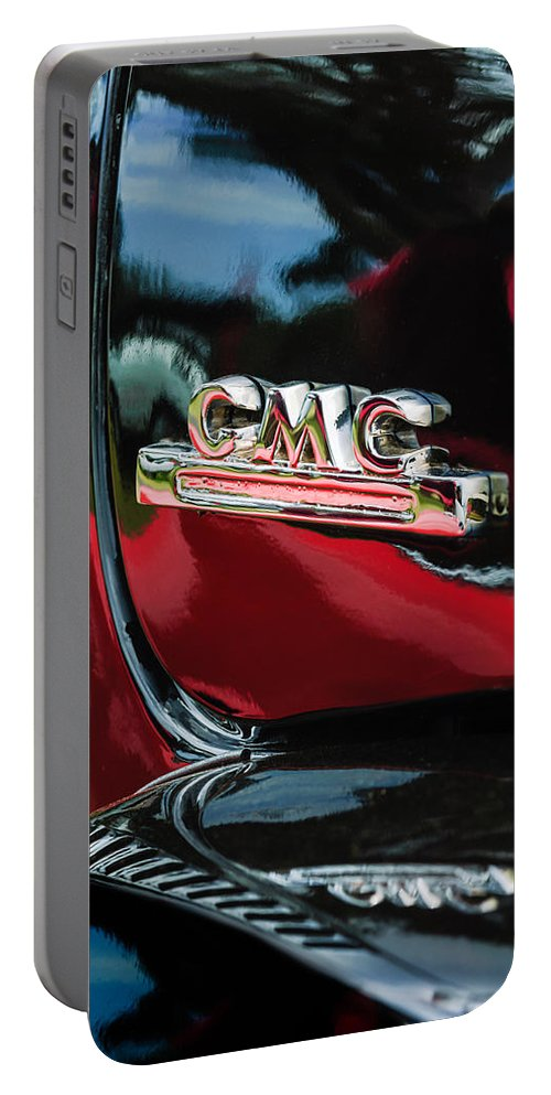 1952 Gmc Suburban Emblem Portable Battery Charger featuring the photograph 1952 Gmc Suburban Emblem by Jill Reger