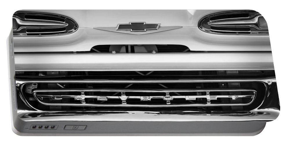 1961 Chevrolet Grille Emblem Portable Battery Charger featuring the photograph 1961 Chevrolet Grille Emblem by Jill Reger