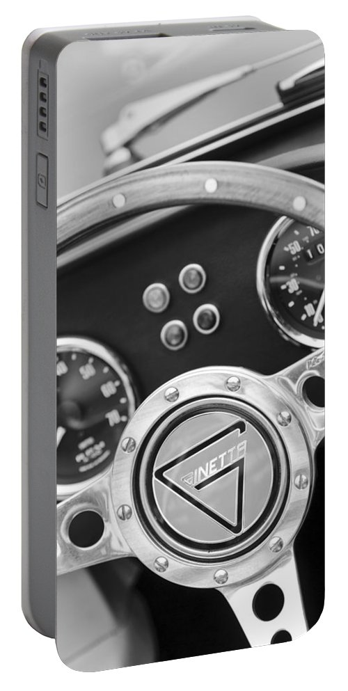 1972 Ginetta Steering Wheel Emblem Portable Battery Charger featuring the photograph 1972 Ginetta Steering Wheel Emblem by Jill Reger