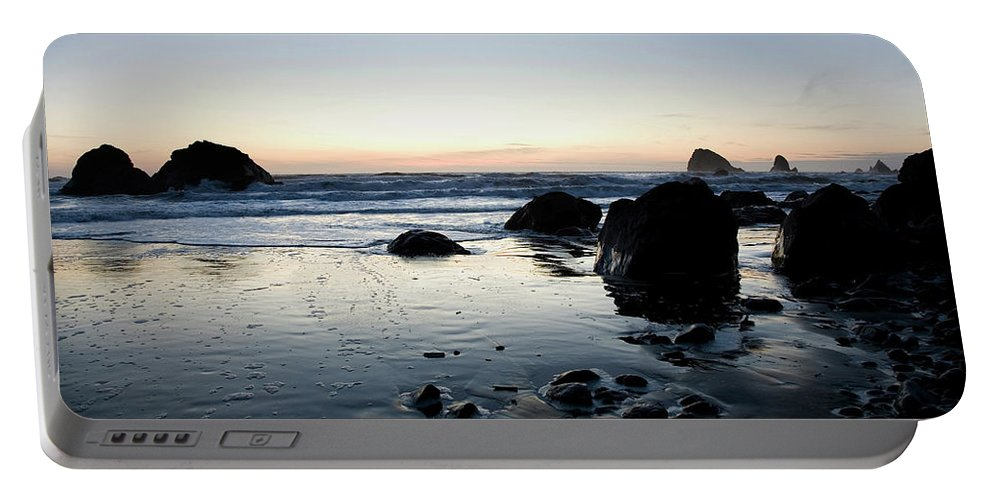 California Portable Battery Charger featuring the photograph A Landscape Of Rocks On The Coast by Michael Hanson