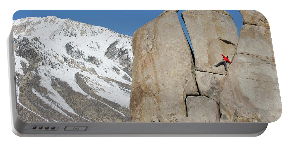 20-24 Years Portable Battery Charger featuring the photograph A Man Sport Climbs In Bishop by Corey Rich