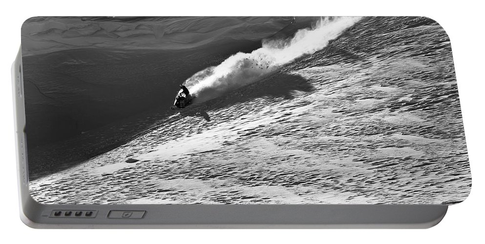 20-24 Years Portable Battery Charger featuring the photograph A Snowmobiler Jumping Off A Cornice by Patrick Orton