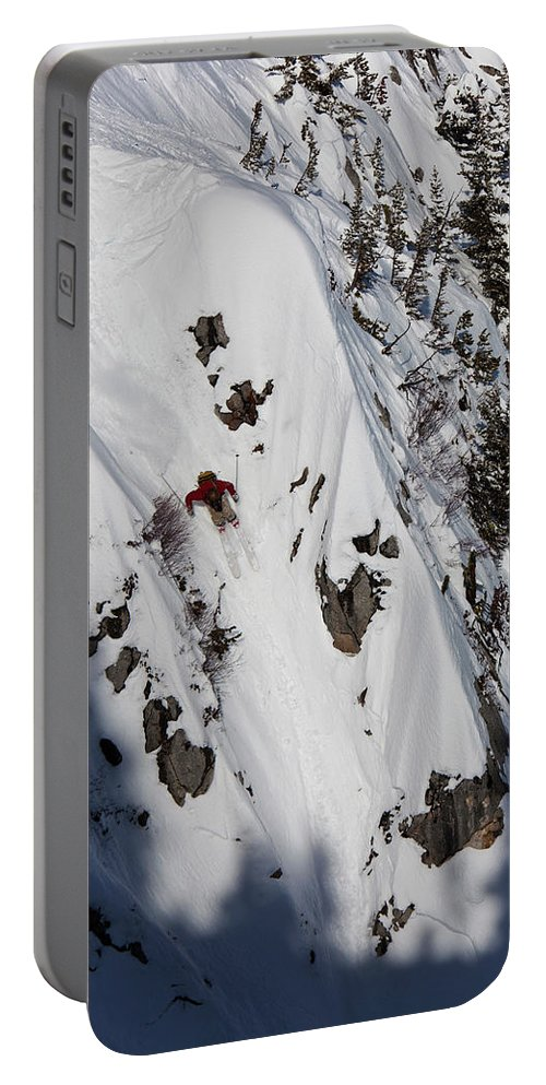 Bozeman Portable Battery Charger featuring the photograph A Telemark Skier In A Narrow Chute by Patrick Orton