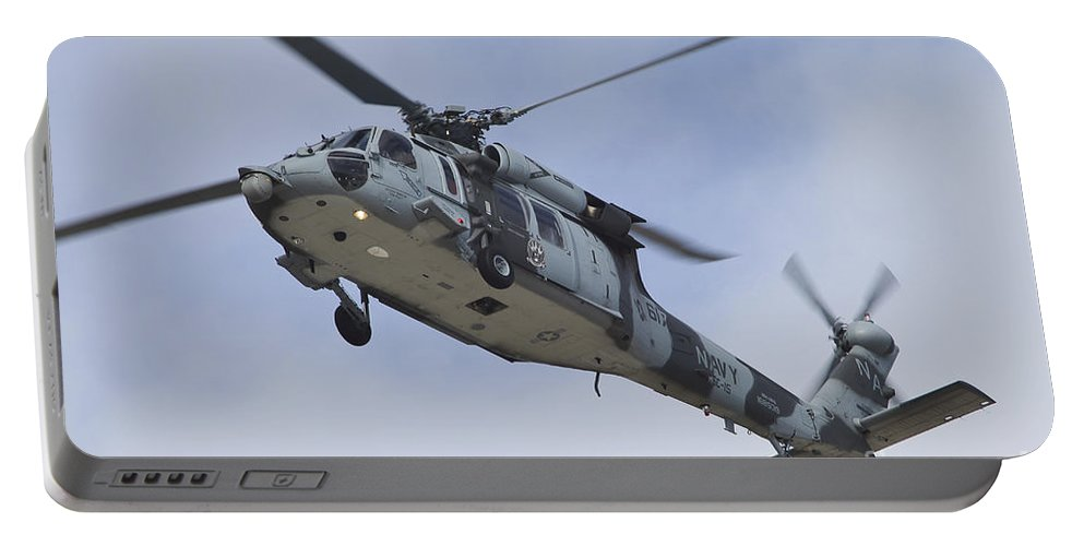 Horizontal Portable Battery Charger featuring the photograph A U.s. Navy Mh-60s Seahawk In Flight by Timm Ziegenthaler
