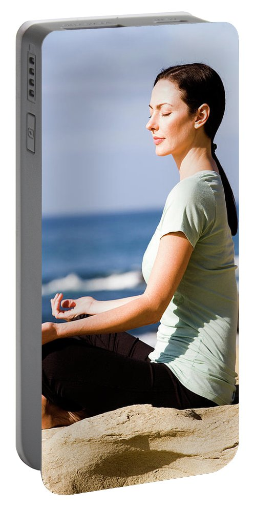 Beach Portable Battery Charger featuring the photograph A Women Meditates On The Beach by Jay Reilly