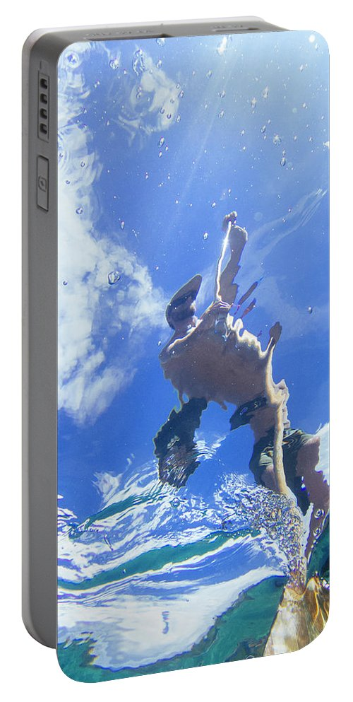 30-34 Years Portable Battery Charger featuring the photograph A Young Man Stand-up Paddleboards by Keri Oberly