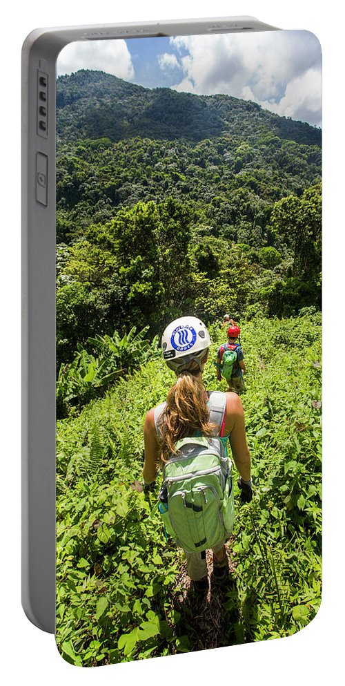 Outdoors Portable Battery Charger featuring the photograph A Young Woman Hikes Through The Jungles by Michael Hanson