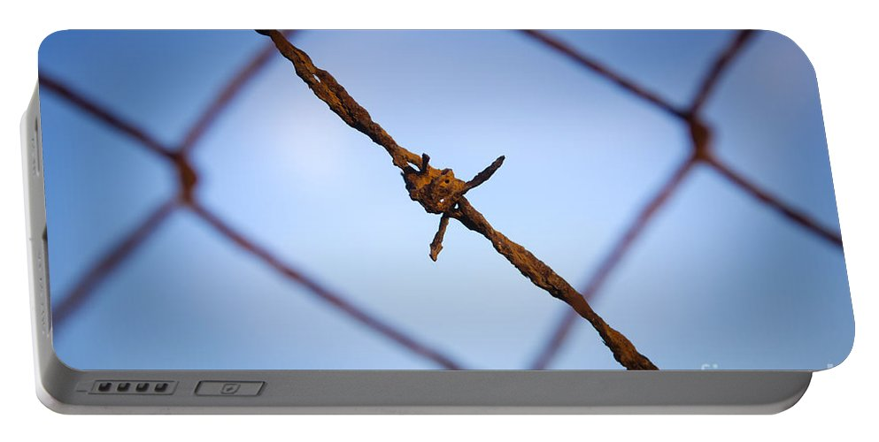 Macro Portable Battery Charger featuring the photograph Barbed Wire by Tim Hester