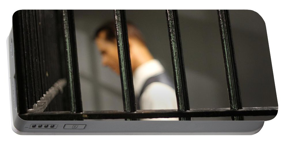 Behind Bars Portable Battery Charger featuring the photograph Behind Bars by Dan Sproul