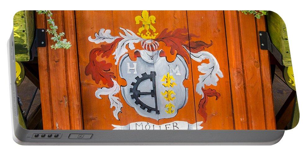 Estonia Portable Battery Charger featuring the photograph Cafe Decor - Tallin Estonia by Jon Berghoff