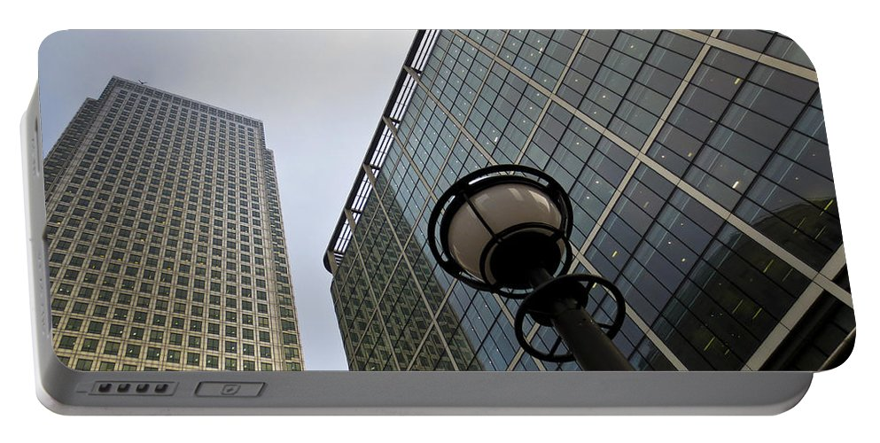 Abstract Portable Battery Charger featuring the photograph Canary Wharf London by David Pyatt