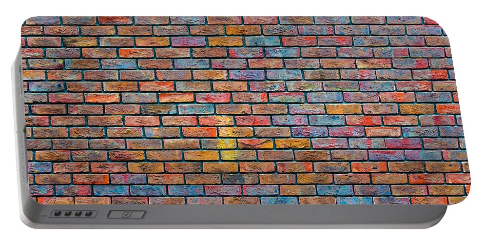 Pattern Portable Battery Charger featuring the photograph Colorful Brick Wall Texture by Dutourdumonde Photography