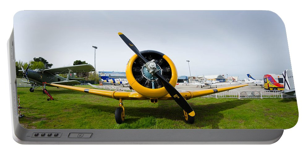 Cuatro Portable Battery Charger featuring the photograph North American T-6 Texan by Pablo Lopez