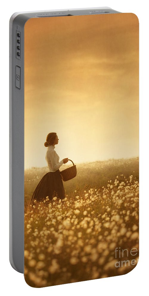 Edwardian Portable Battery Charger featuring the photograph Edwardian Woman In A Meadow At Sunset by Lee Avison