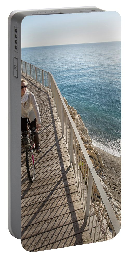 Woman Portable Battery Charger featuring the photograph Elevated Perspective Of Woman Riding by Philip & Karen Smith / TFA