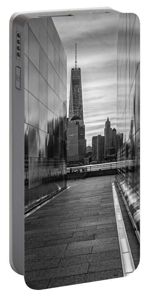 Financial District Portable Battery Charger featuring the photograph Empty Sky Memorial And The Freedom Tower by Susan Candelario