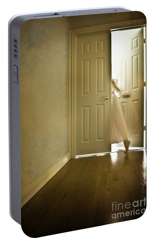 Memory; Woman; Female; Lady; Ghost; Caucasian; Dress; Pink; Flowing; Blur; Foot; Barefoot; Door; Doorway; Wood Floors; Closed; Open; Going Into The Light; Light; Bright; Heaven; Death; Wall; House; Home; Indoors; Inside; Hall; Foyer; Walking; Conceptual Portable Battery Charger featuring the photograph Entrance by Margie Hurwich