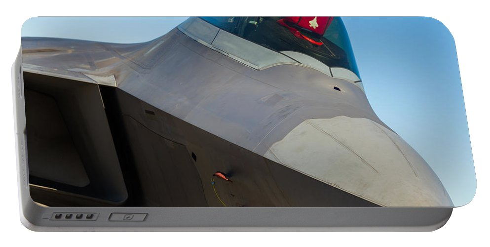 F-22 Portable Battery Charger featuring the photograph F-22 Raptor Jet by Raul Rodriguez