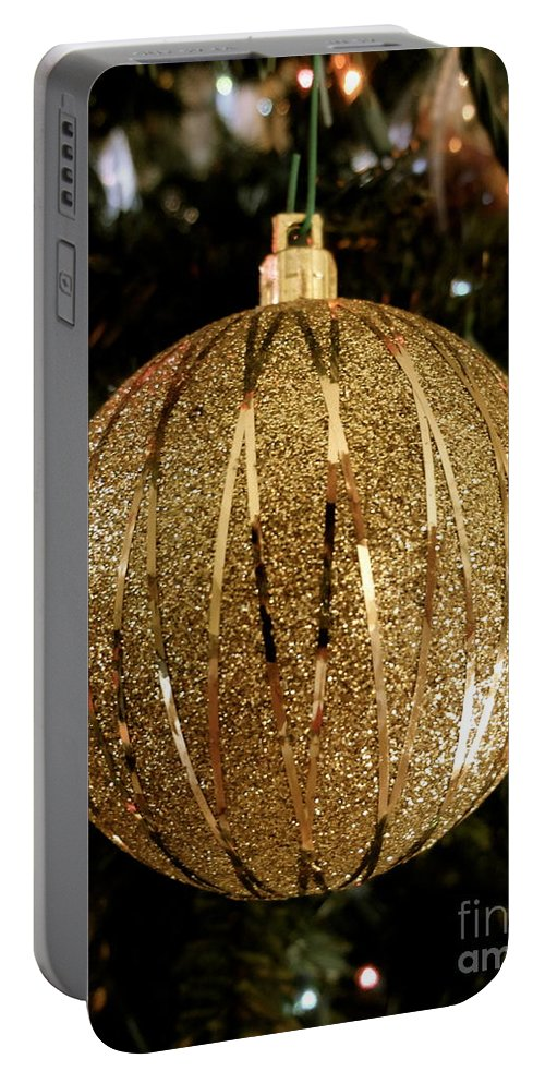 Christmas Portable Battery Charger featuring the photograph Gold Ornament by Jacqueline Athmann