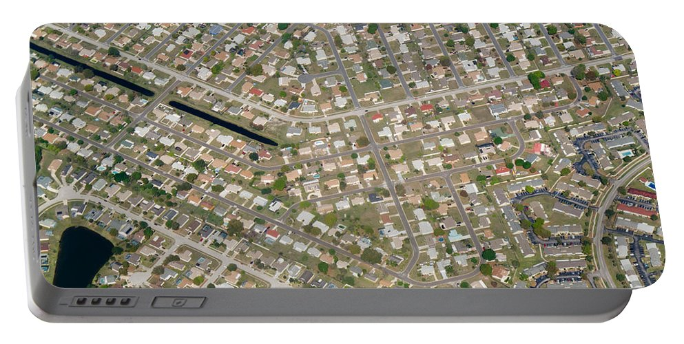 Aerial Portable Battery Charger featuring the photograph Housing Development, Florida by John Shaw