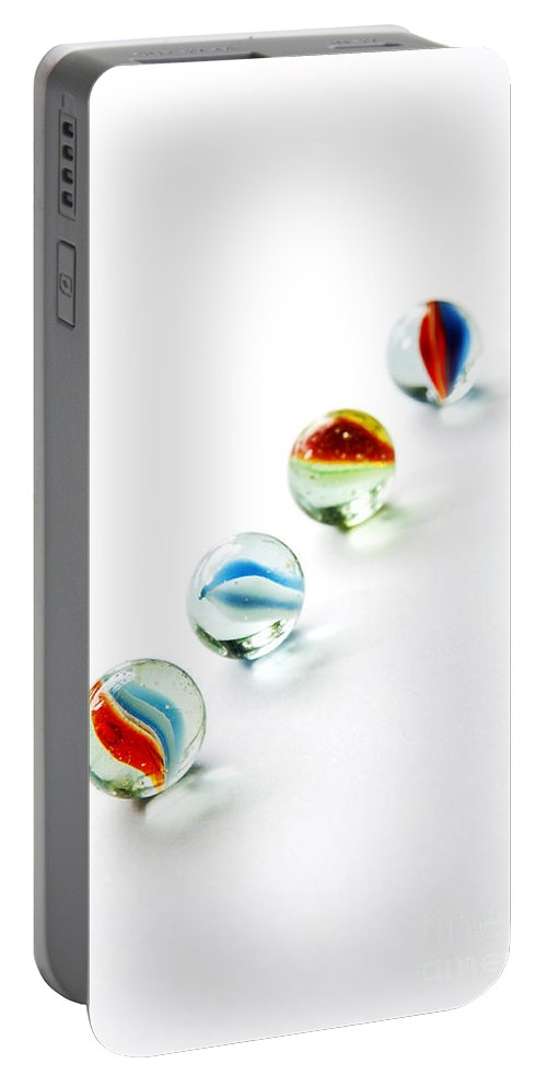 Abstract Portable Battery Charger featuring the photograph Isolated Marbles by Tim Hester
