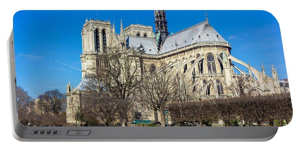 Blue Sky Portable Battery Charger featuring the photograph Notre Dame De Paris by Pati Photography