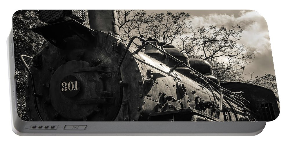 Antique Portable Battery Charger featuring the photograph Old Black Locomotive Engine Details by Alex Grichenko