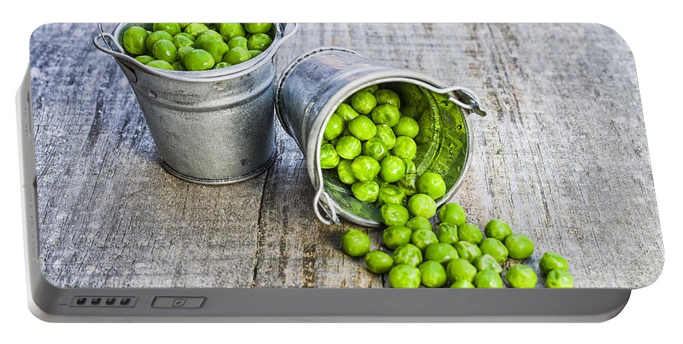 Ice Portable Battery Charger featuring the photograph Peas by Paulo Goncalves