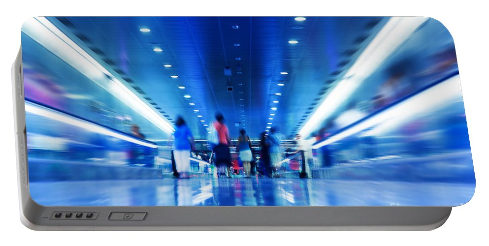Metro Portable Battery Charger featuring the photograph People Rush In Subway by Michal Bednarek