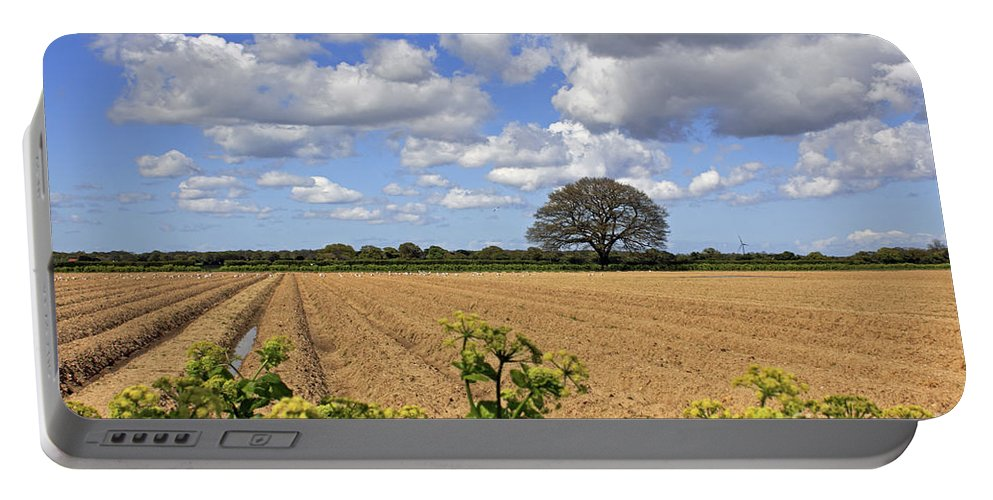 Ploughed Field Britain British English Landscape Uk United Kingdom Farm Farmland Agriculture Sunny Sunshine Suffolk Blue Sky Seaside Oak Tree Fluffy Clouds Hedgerow Portable Battery Charger featuring the photograph Ploughed Field by Julia Gavin