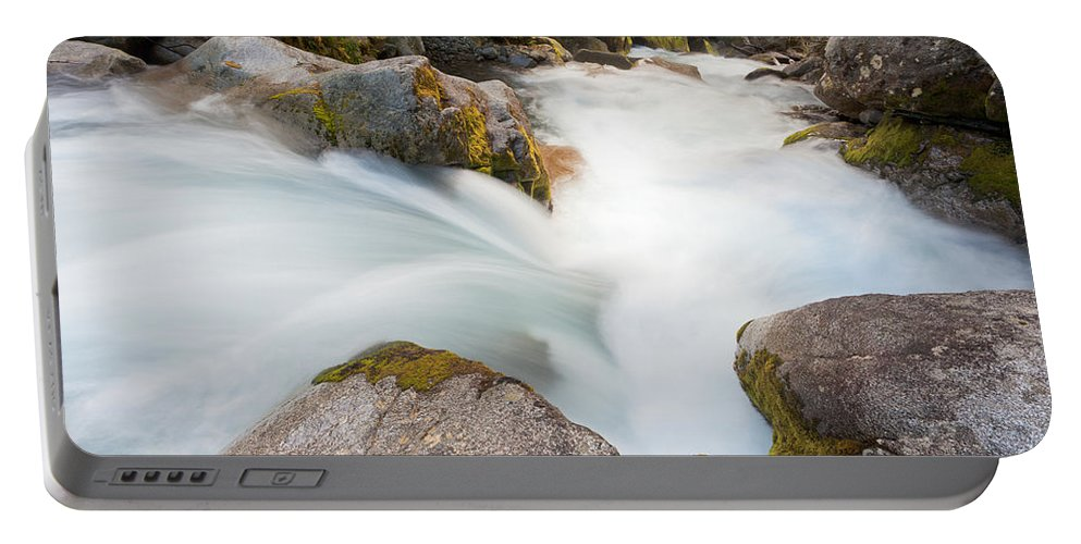 Cascade Portable Battery Charger featuring the photograph River Rapids Washing Over Rocks With Silky Look by Stephan Pietzko
