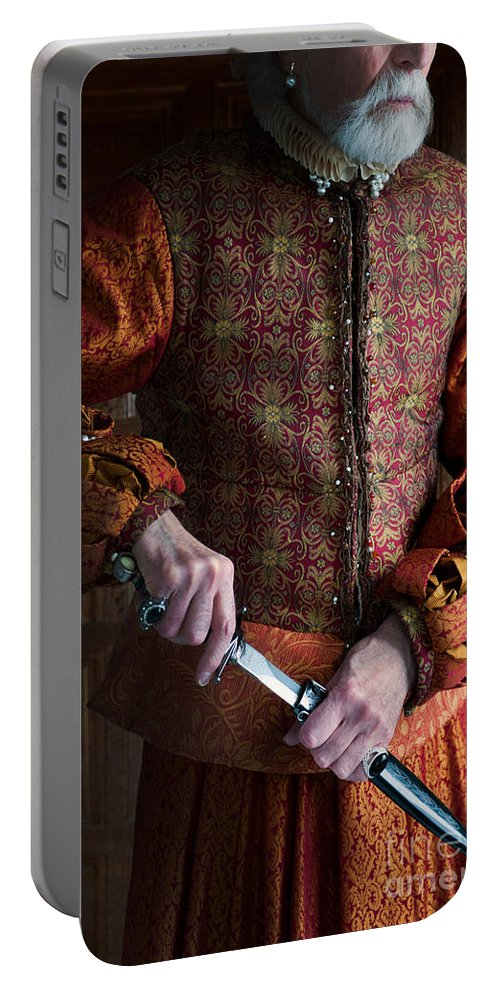 Medieval Portable Battery Charger featuring the photograph Senior Tudor Man Drawing A Dagger by Lee Avison