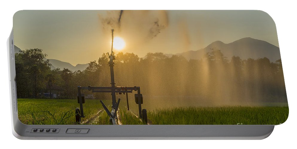 Sunrise Portable Battery Charger featuring the photograph Sprinkler Irrigation by Mats Silvan