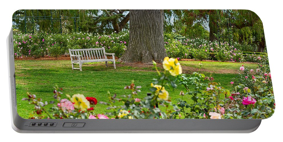 Rose Garden Portable Battery Charger featuring the photograph Stop And Smell The Roses by Jamie Pham